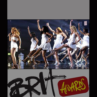 Beyonce with dancers performing at BRITS 2004